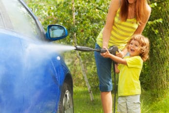 mom and son washing the car
