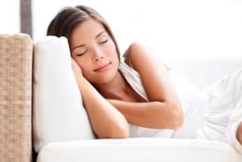 a lady sleeping on a sofa