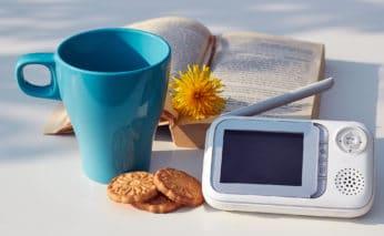 a baby monitor, a mug and a book