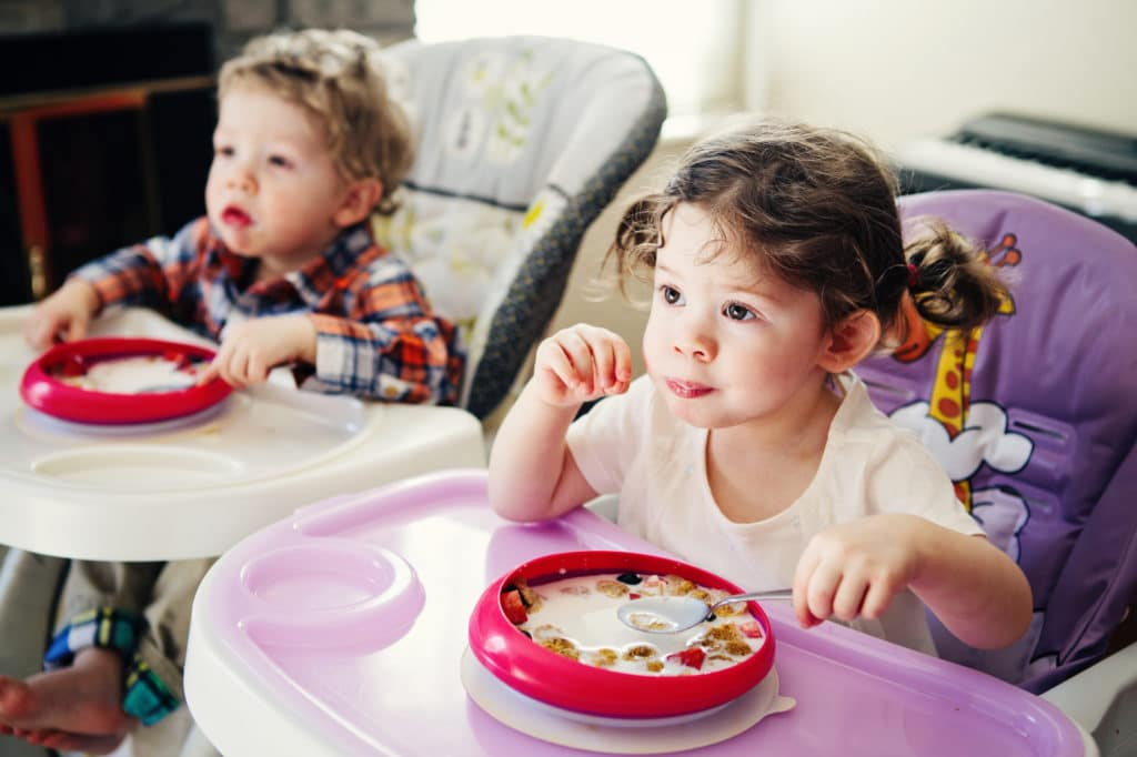two children eating their meal