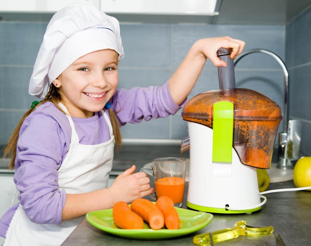 little girl making a fresh drink