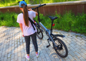 a girl with her bicycle