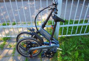 folded bike on a fence