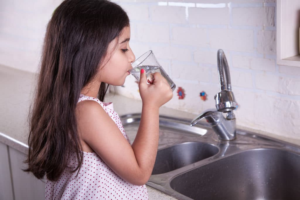 a girl drinking pure clean water
