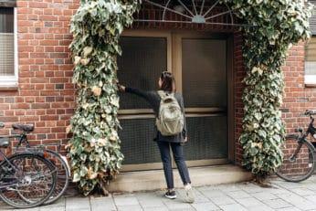 girl ringing a doorbell