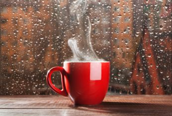 steaming hot coffee on a rainy day