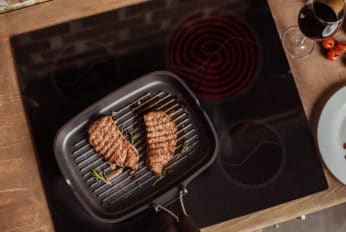 grilled steaks in a frying pan