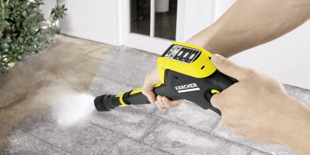 uising a pressure washer to clean concrete floor