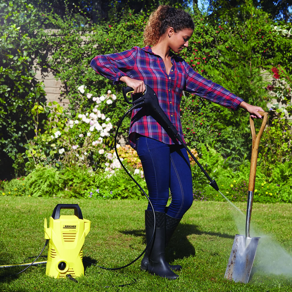 woman cleaning a showel