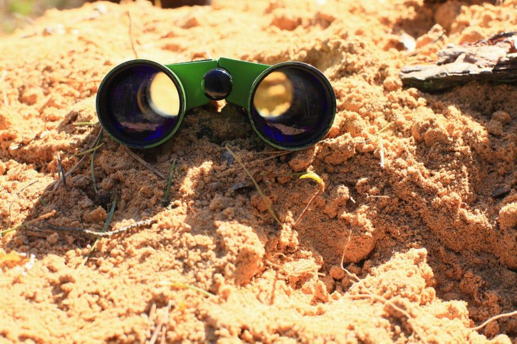dirty binoculars on the sand
