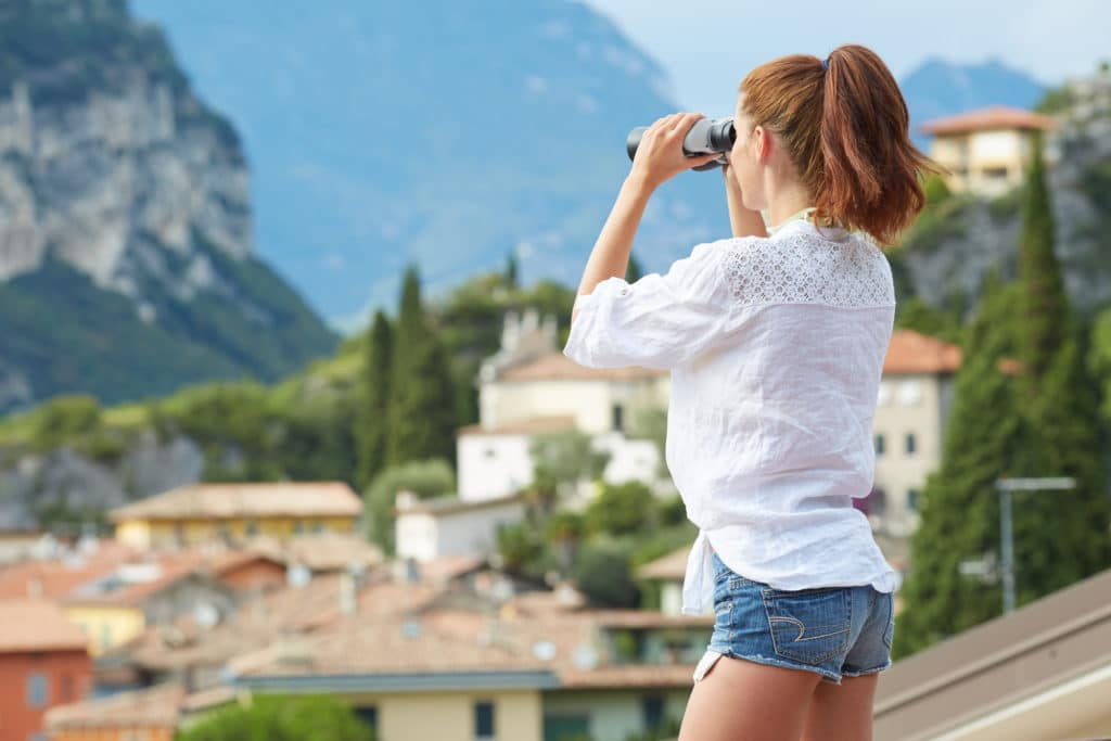 woman looking through her binoculars
