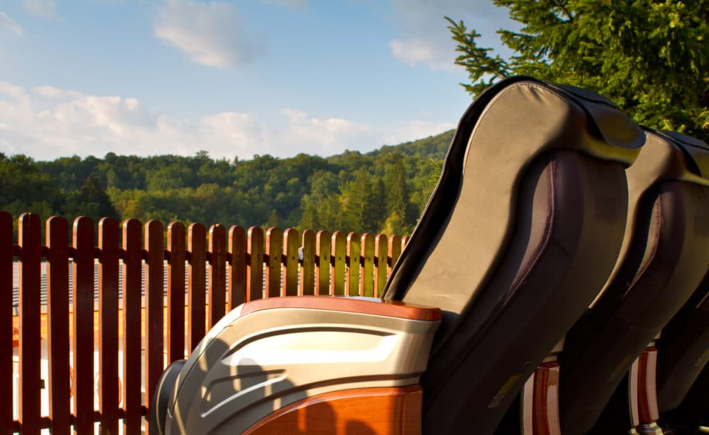 a row of massage armchairs outdoors