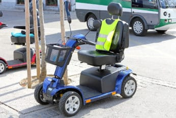 blue 4-wheel mobility scooter with a front basket