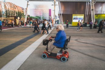 elderly woman on a scooter