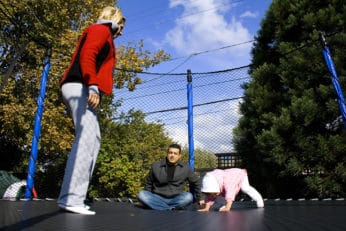 a family on the trampoline