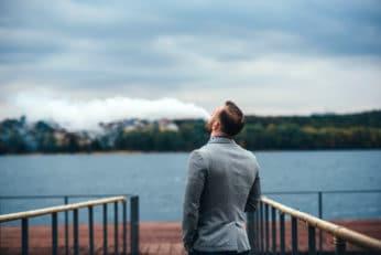 a man making vape clouds outdoors