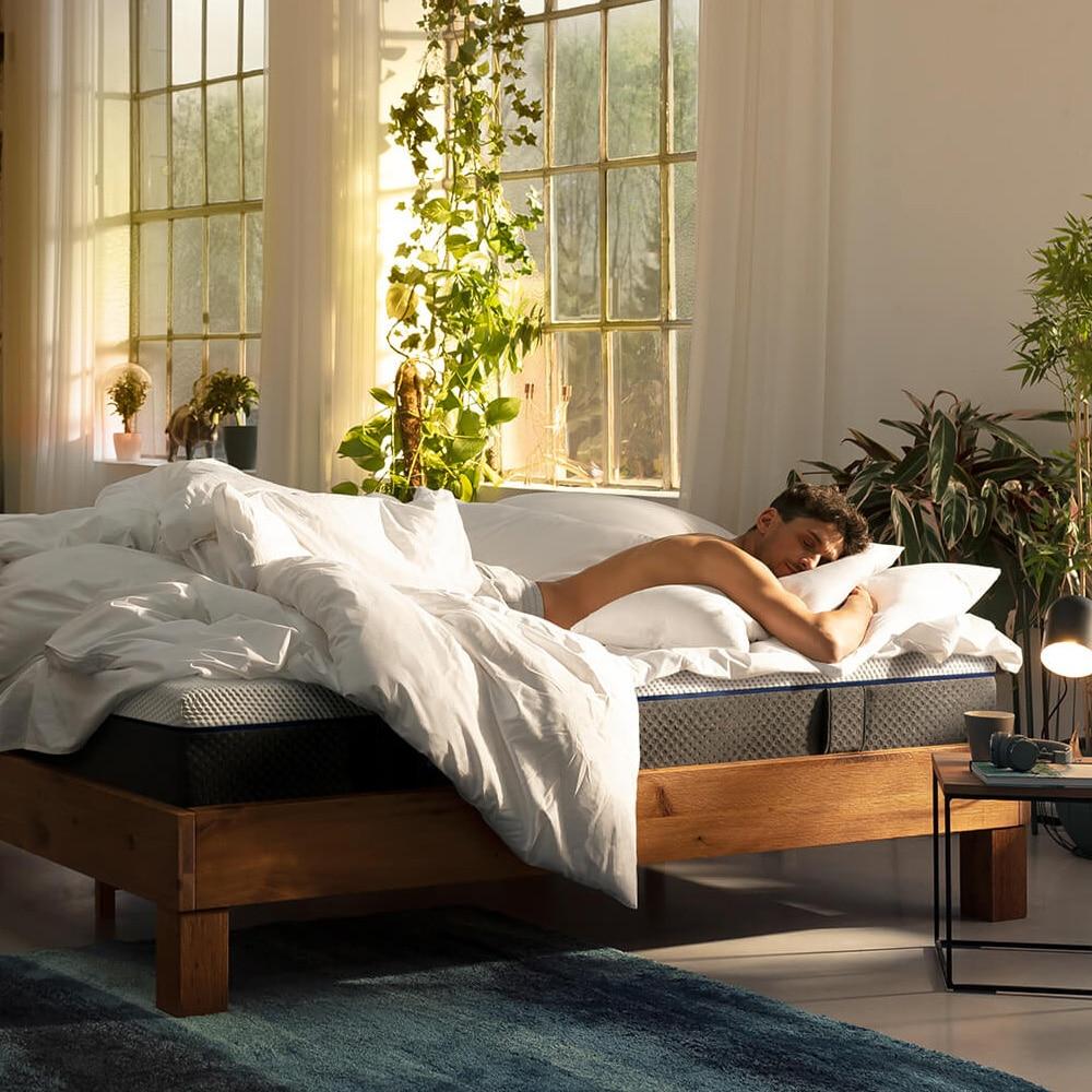 man on an Emma Original bed
