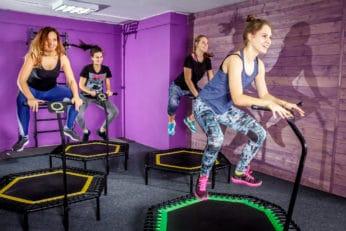 women jumping during a trampoline workout class