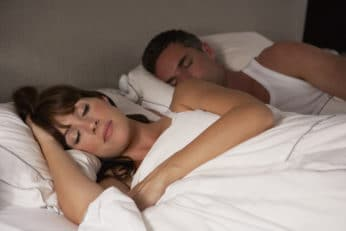 a couple asleep in bed