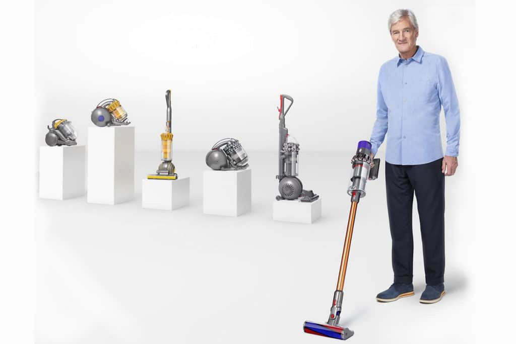 James Dyson with his product line