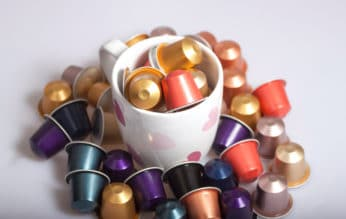 capsules in and around a cup