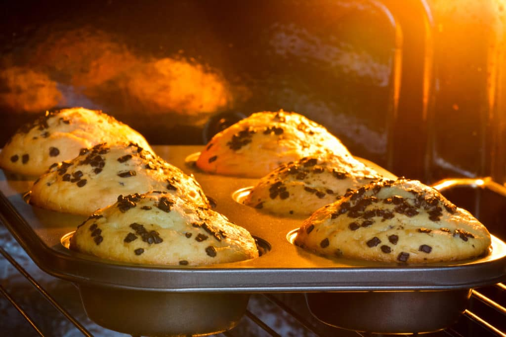 close-up of muffins being baked