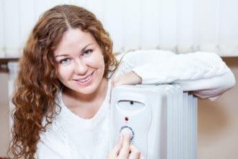 happy woman adjusting the temperature