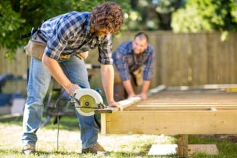 two men busy with their outdoor project