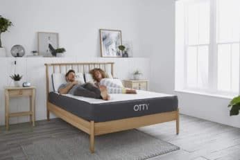 a couple sleeping on the Otty bed