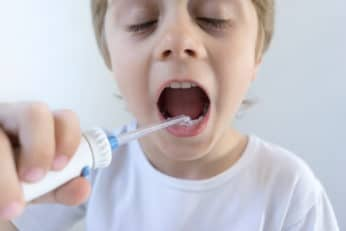 boy using an oral irrigator