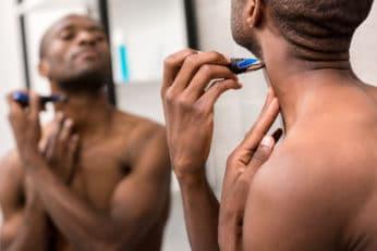 man trimming his facial hair
