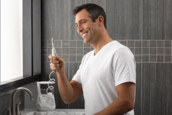 man using the Waterpik Ultra