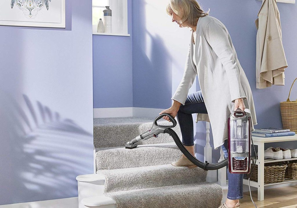 vacuuming stairs with a handheld