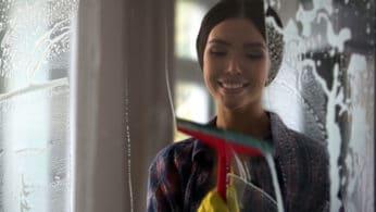 woman washing a glass surface