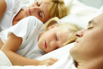 a family sleeping altogether