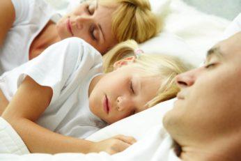 a family sleeping altogether