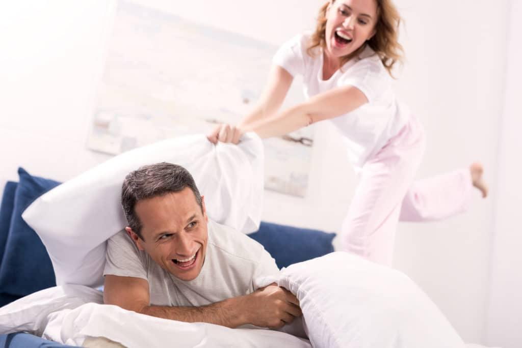 couple playing int he bedroom
