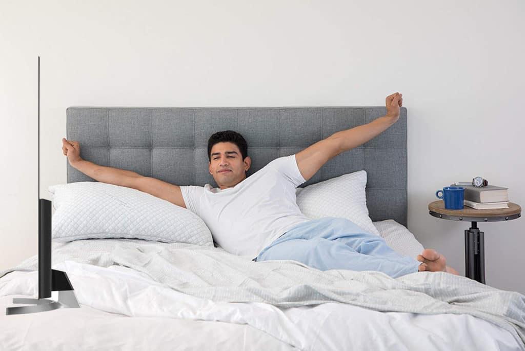 man using PureComfort in the bedroom