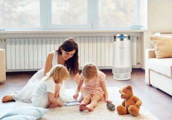 a family using an air purifier