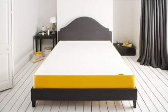 bed on a black bedframe