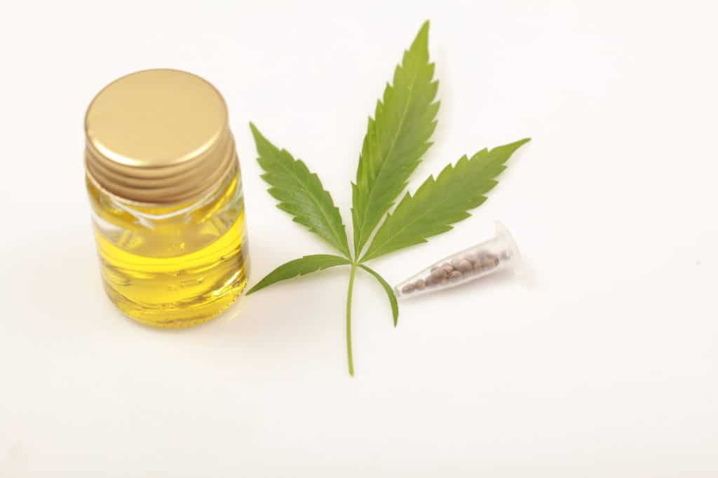 cannabis and a bottle of cbd oil