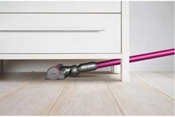 vacuuming underneath a drawer cabinet