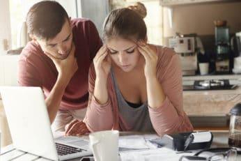 a couple facing financial stress