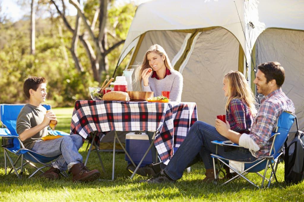 a family enjoying a camping holiday