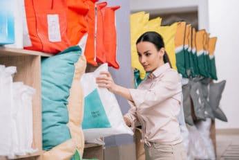 a lovely woman choosing a pillow