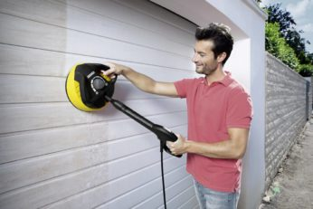 a man cleaning a wall using T350 surface cleaner