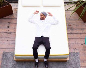 a man comfortably lying on a mattress