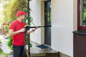 pressure washing a wall
