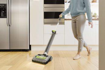 vacuuming the kitchen floor