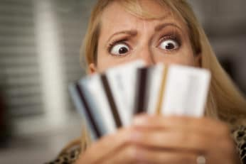 woman holding up many cards